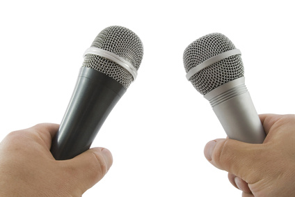 Hand with wireless microphone