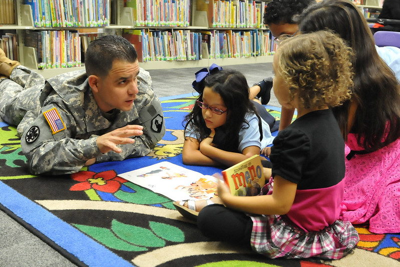 Army 2nd Lt. Monserrate Vergara from the 1st Mission Support Command, U.S. Army Reserve Puerto Rico, reads a Thanksgiving book to children during a story time event. Tell stories as part of your nonprofit's outreach.